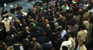 Tower Hamlets Firs candidates gather at the count to hear informal news on the mayoral vote.