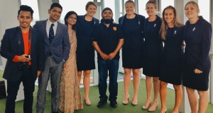 Emdad Rahman (centre) squeezes into the Women's Cricket Team - on a temporary basis!
