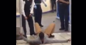 The attacker lies on the ground, having been disabled by the police taser.