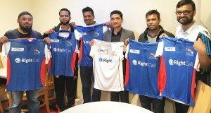 Club Char Emdad Rahman (left) and players display the team's new strip.