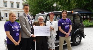 Jack takes his cheque to meet the Barts staff.