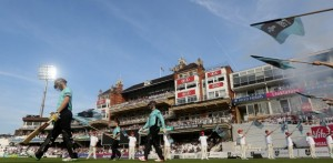 Jason Roy and Rory Burns of Surrey walk out on to the field of play during the NatWest T20 Blast match between Surrey and Hampshire at The Kia Oval on 9th June. (Photo by Charlie Crowhurst/Getty Images)