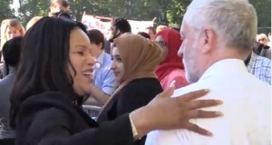 Jeremy Corbyn being welcomed to the rally by one member of the audience.