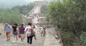 Tourists make their way along the Great Wall of China - a rather different boundary wall from what is planned in Calais.