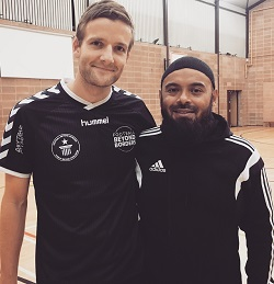 World record captain Theo Strong in black Hummel shirt with referee Emdad Rahman.