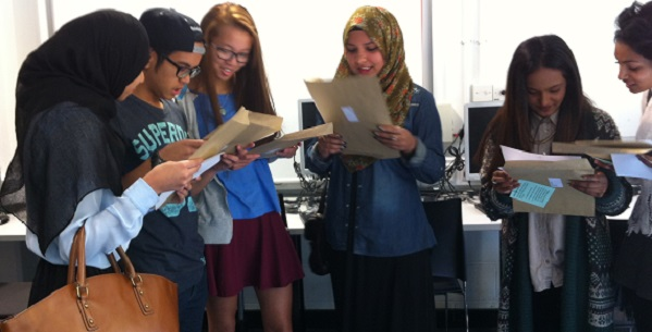 A mixed group of Tower Hamlets pupils enjoy their GCSE results: what employment opportunities will they go on to have?