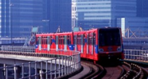 DLR train leaves Canary Wharf, heading for Custom House.  (c) Transport for London
