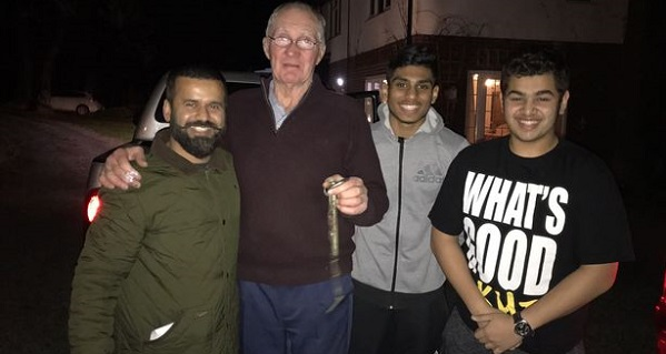 Cllr Mahbub Alam (left) with the Welsh man who helped him and his nephew Shaiam and son Mazhar