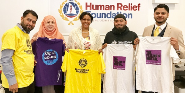 Khoyrul Shaheed (left), Cate Tuitt (centre), Emdad Rahman (second from right) and other members of the HRF team