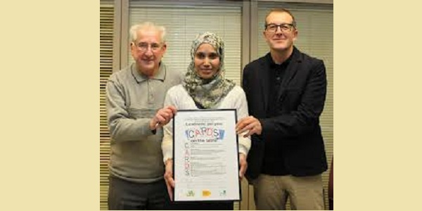 Federation Chair Phil Sedler (left) with the Federation's Residents Charter - at the signing with the then Housing Lead Member  Cllr Rabina Khan and the then Chief Executive of Tower Hamlets Homes Gavin Cansfield.