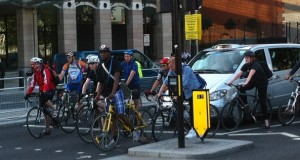 Cyclists and pedestrians struggle to breathe in a London polluted by motor vehicles.