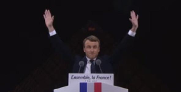 Macron celebrates victory.