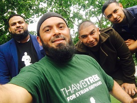 Emdad (foreground) and firends promote the Thawb Trek.