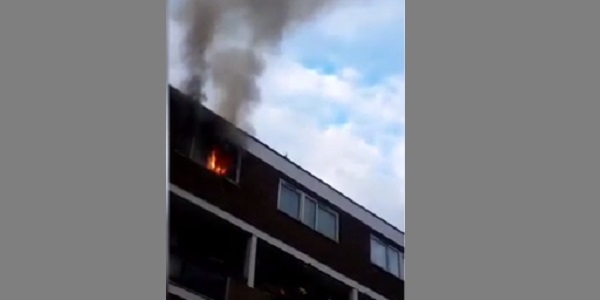 Flames can clearly be seen in the fourth floor room, seconds after the teenager jumped out.