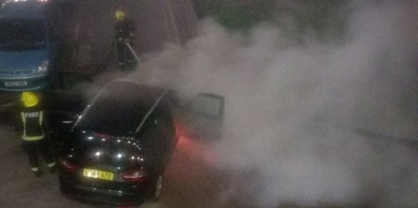 Firefighters tackle the small fire outside Reef House, E14