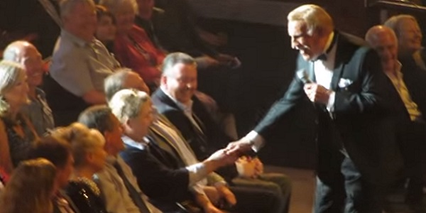 Bruce Forsyth, stepping down from the stage to greet the audience during one of his last stage shows.