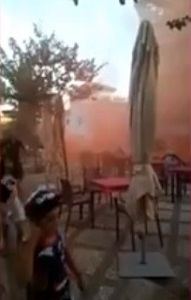 Granada: worshippers run as smoke from attack flare as begins to billow out of the mosque.