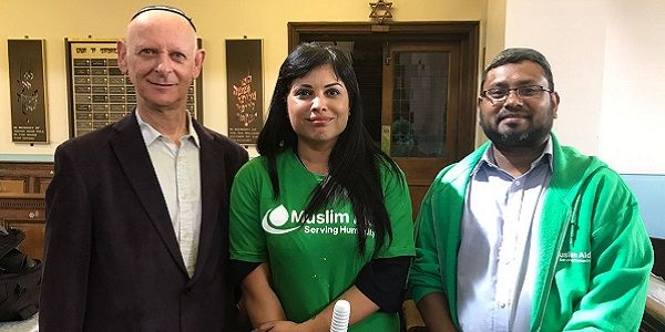 Left to right: Leon Silver of the Nelson Street Synagogue, fellow cleaner Natasha Bolter and Canary Wharf Councillor Maium Miah.