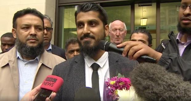 Muhammad Rabbani greets reporters outside Court.