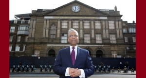 Mayor Lutfur Rahman standing outside the iconic Royal London Hospital building - which he saved for the public sector by acquiring it for a new Town Hall.