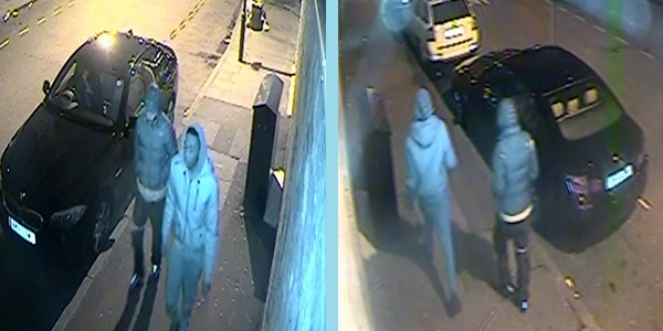 Two men head towards and walk past a CCTV camera - can they help police with solving this murder?