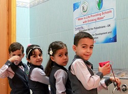Children enjoy their clean drinking water at school.